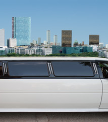limousine with skyscrapers on the background