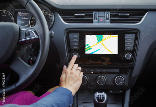 Woman using navigation system while driving a car Poster