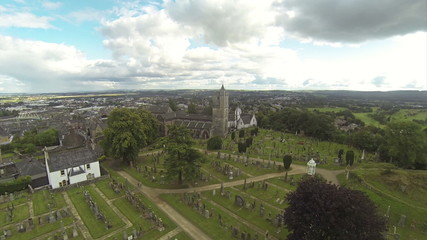 Two scenes of camera flying over cemetery near Stirling castle i