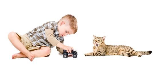 Boy playing near the cat