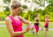 blond woman setting her timer before jogging