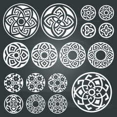 A set of of white round geometric designs