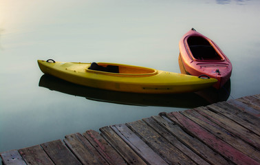 Yellow and Red Kayak on the lake