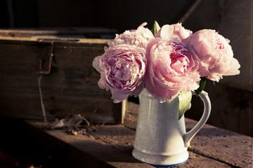 Bouquet of pink peonies in vase, textured