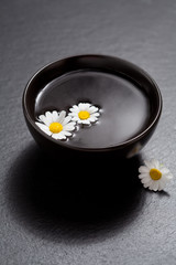 Spa setting with daisies in water