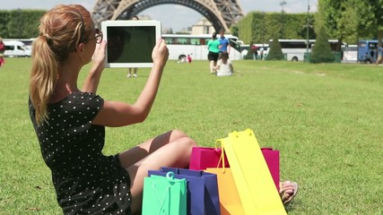Woman using digial tablet in the park