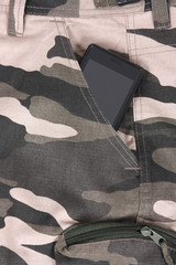 phone in the pocket of woodland camoflauge