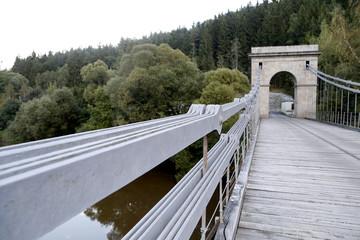 Old chain bridge over the river Luznice in the Czech republic