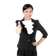 Young business woman showing like sign by thumb's up