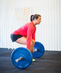 Woman Picking Barbell