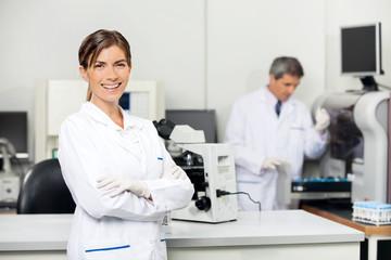 Smiling Female Scientist In Laboratory