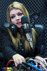 Beautiful Woman Recording Sound In Media Studio