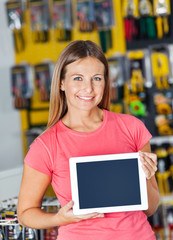 Woman Showing Digital Tablet In Hardware Store