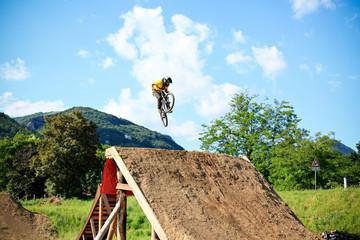 Mountain bike free style athlet make a big jump