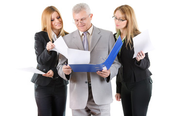 Three smiling business people looking at documents