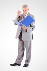Senior Businessman with glasses looking at documents
