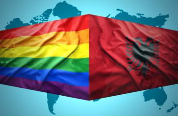 Waving Albanian and Gay flags