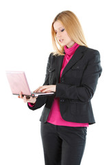 Beautiful businesswoman using her laptop