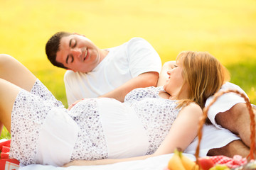 Pregnant couple relaxing