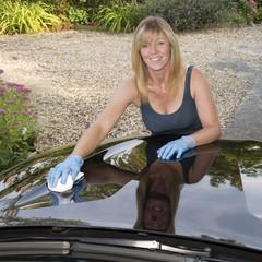 Woman polishing car bonnet