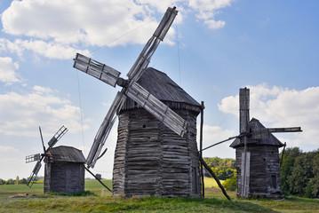 Old wooden windmills on background of blue sky, Kyiv region