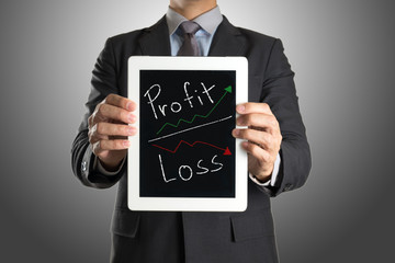 businessman with tablet Profit and Loss investment