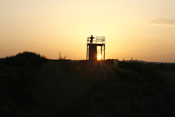 Silhouette of a young rider in the bike park.