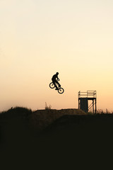 Silhouette of a young rider on a bike in the bike park.