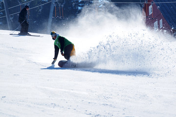 Young snowboarder enjoys winter fun in the snow.