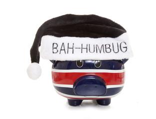piggy bank wearing a scrouge bah humbug hat