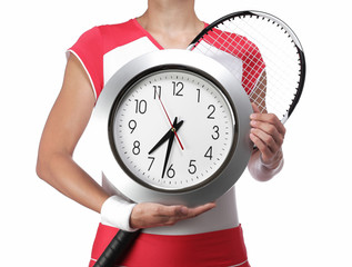 female tennis player holding a clock