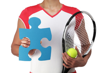 female tennis player showing a piece of puzzle