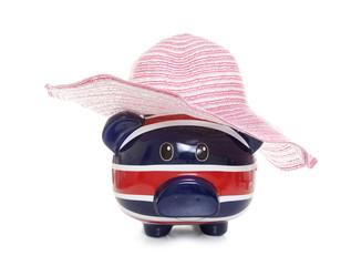piggy bank wearing a pink summer hat