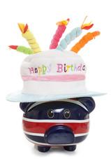 piggy bank wearing a happy birthday hat