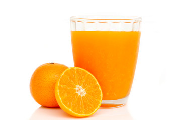 Glass of orange juice with sliced orange on white background