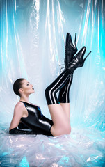 Woman in latex fetish outfit