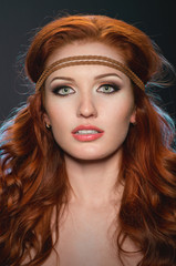 Studio portrait of pretty redhead woman