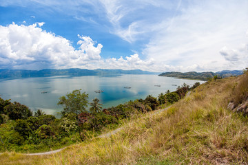 Amazing landscape view to the tranquil lake in tropics with moun