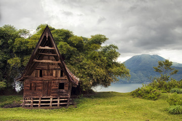 An old wooden abondoned house like from fairy tale nearby lakesi