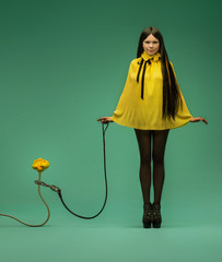 Fashion shot of a girl with yellow water lily
