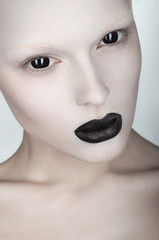 Woman face with white skin and black lips