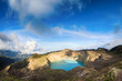 Steaming voulcanic colorful lakes in Kelimutu kraters on a brigh