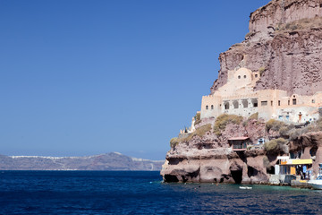 Ancient building in the port of Fira, Santorini island, Greece