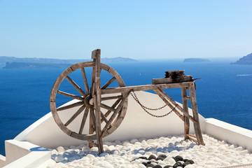 Old craftsmanship machine on the roof. Santorini island, Greece