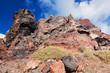 Obrazy na płótnie, fototapety, zdjęcia, fotoobrazy drukowane : Cliff and volcanic red rocks of Santorini island, Greece.