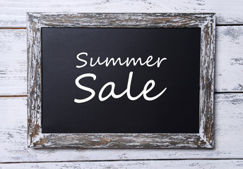 Summer sale written on chalkboard, close-up