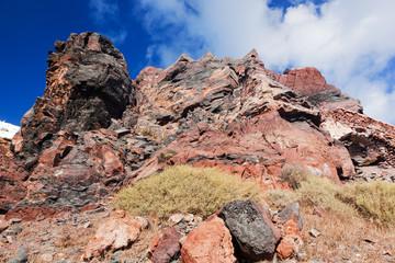 Cliff and volcanic red rocks of Santorini island, Greece.