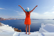 canvas print picture - Happy tourist woman on Santorini island, Greece. Travel