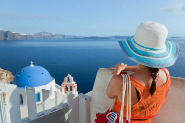 Happy tourist woman on Santorini island, Greece. Travel