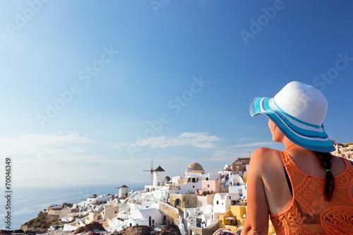 canvas print picture Happy tourist woman on Santorini island, Greece. Travel